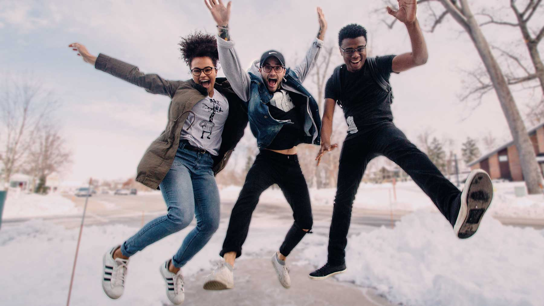 Business owners jumping for joy about their business websites by perk brands